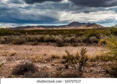West Texas Landscape of Desert Area with Hills, Scrub Brush, and Interesting Clouds.