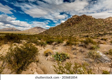 West Texas Landscape of Desert Area with Hills and Blue Sky with Clouds.