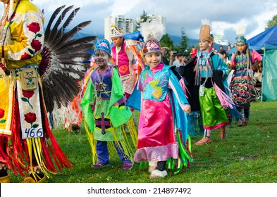 WEST VANCOUVER, BC, CANADA - AUGUST 30 : First Nation Royal Kids take part in Grand Entry of the Squamish Nation 27th Annual Pow Wow in West Vancouver, Canada on August 30 2014