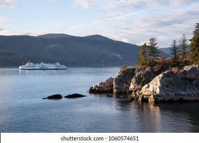 West Vancouver, British Columbia, Canada - March 06 2018: BC Ferries passing by Whytecliff Park during a vibrant sunset.