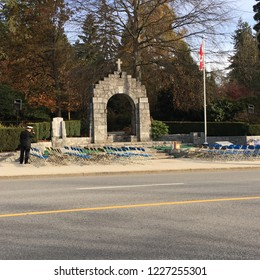 WEST VANCOUVER, BRITISH COLUMBIA, CANADA - NOVEMBER 11, 2018: The cenotaph with empty seats waiting for the veterans to arrive on Remembrance Day.