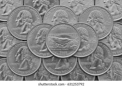 West Virginia State and coins of USA. Pile of the US quarter coins with George Washington and on the top a quarter of West Virginia State.
