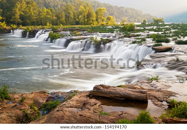 West Virginia's New River, a national scenic river, tumbles over a very wide and very beautiful waterfall near Hinton called Sandstone Falls