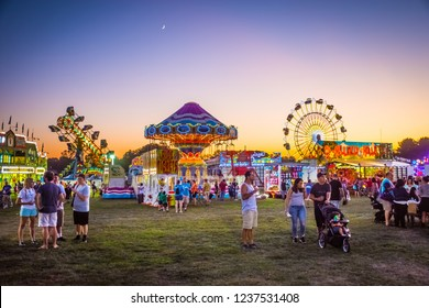 WEST WINDSOR, NEW JERSEY - September 23 - Amusement park rides and plenty of people attended The 18th Annual Mercer County Italian American Festival on September 23, 2017 in West Windsor NJ.