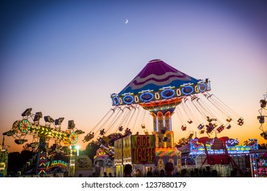 WEST WINDSOR, NEW JERSEY - September 23 - Amusement park rides at night at the Mercer County Italian American Festival on September 23, 2017 in West Windsor NJ.