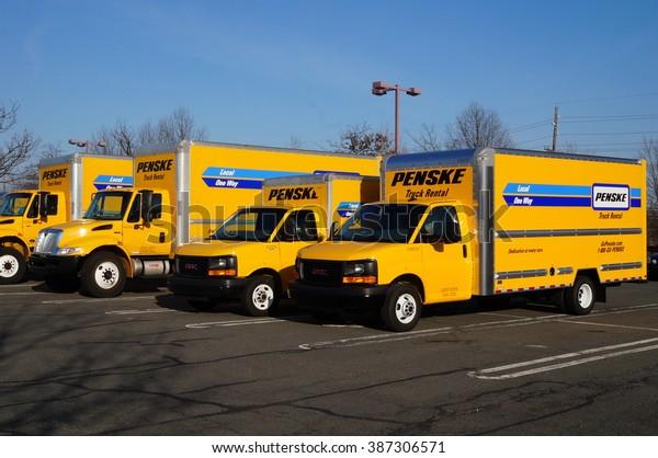 WEST WINDSOR, NJ -7 MARCH 2016- A fleet of yellow Penske rental trucks. Headquartered in Pennsylvania, Penske rents and leases commercial trucks.