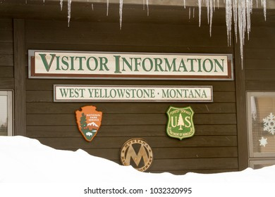West Yellowstone, Montana, USA - February 8, 2018 :  Visitors Center in West Yellowstone Montana in winter with icicles .