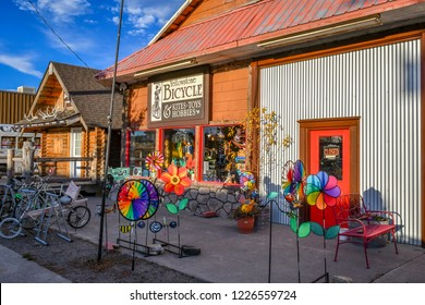 West Yellowstone, Montana / USA - September 28 2018: Bicycle shop along Canyon Street