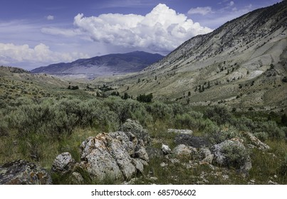 West Yellowstone, Wyoming, USA. The arid landscape of the prairies with sagebrush, mountains, grasses, on a bright sunny day in summer near Cooke City, Montana, USA.