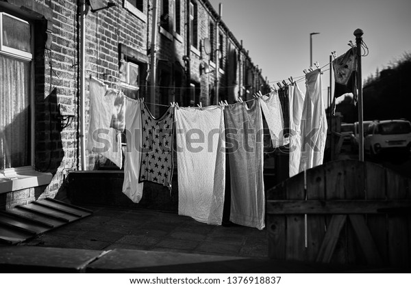 West Yorkshire, England - Mar 2019: Monochrome photo of a clothes line with laundry drying in the sun