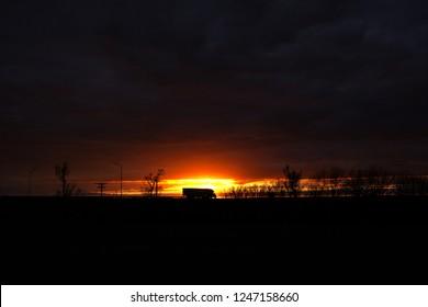 westbound truck on interstate 70 during sunset