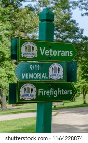 Westbury, NY - August 21, 2018: This sign indicates the location of the Veterans, Firefighters, and 9/11 Memorials in Eisenhower Park.