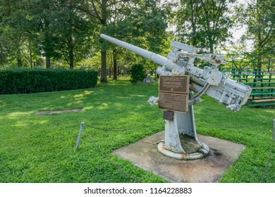 Westbury, NY - August 21, 2018: Two commemorative plaques to the Merchant Marine and U.S.N. Armed Guard are mounted on a vintage anti aircraft naval gun that sits at Veterans Plaza in Eisenhower Park.