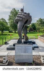 Westbury, NY - August 21, 2018: This 12 foot bronze sculpture which is the Monument to the Veterans of the War in Southeast Asia sits at Veterans Plaza in Eisenhower Park.