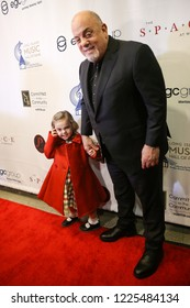 WESTBURY, NY - NOV 8: Billy Joel (R) and daughter Della Rose attend the 2018 Long Island Music Hall of Fame induction ceremony at The Space at Westbury on November 8, 2018 in Westbury, New York.