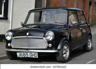 Westbury, UK - April 19, 2017: A vintage Austin Cooper Mini sits parked on a street.The mini car is a uniquely British design icon originally manufactured by BMC and later BMW.