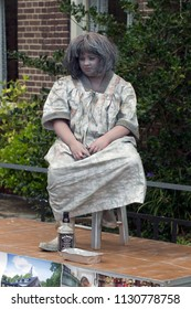 Westerbork, Netherlands- July 8, 2018: Street artist representing drunken woman during Championships living statues in Westerbork, the Netherlands