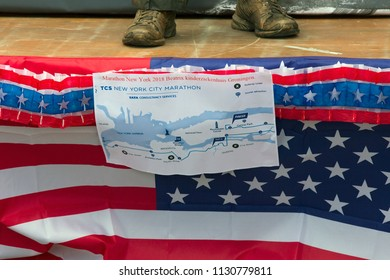 Westerbork, Netherlands- July 8, 2018: Feet of street artist representing marathon runner with the flag of the USA in front during the Championships living statues in Westerbork, the Netherlands