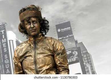 Westerbork, Netherlands- July 8, 2018: Street artist marathon runner with the backdrop of the New York scene during the Championships living statues in Westerbork, the Netherlands