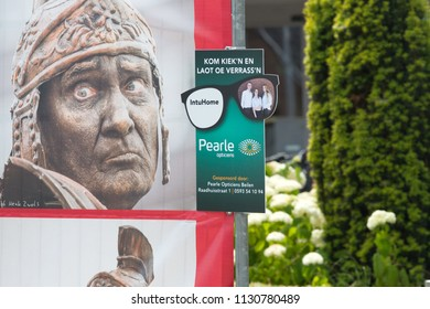 Westerbork, Netherlands- July 8, 2018: Sign with the sponsors Pearle and InTuHome of the Championships living statues in Westerbork, the Netherlands