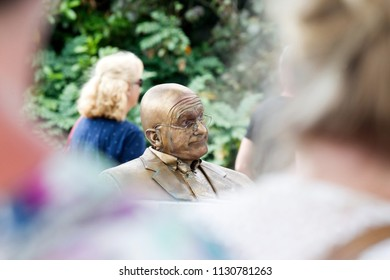 Westerbork, Netherlands- July 8, 2018: Street artist representing a surly man during the Championships living statues in Westerbork, the Netherlands