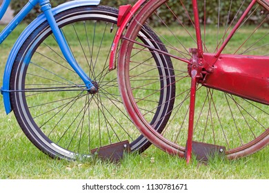 Westerbork, Netherlands- July 8, 2018: Red and blue bike present during the Championships living statues in Westerbork, the Netherlands