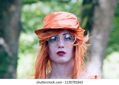 Westerbork, Netherlands- July 8, 2018: In orange dressed street artist representing the time during the Championships living statues in Westerbork, the Netherlands
