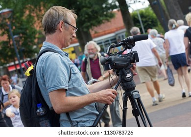 Westerbork, Netherlands- July 8, 2018: hobby filmer during the Championships living statues in Westerbork, the Netherlands