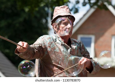Westerbork, Netherlands- July 8, 2018: street artist blowing soap bubbles during the Championships living statues in Westerbork, the Netherlands