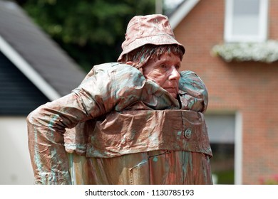 Westerbork, Netherlands- July 8, 2018: street artist in a tond during the Championships living statues in Westerbork, the Netherlands