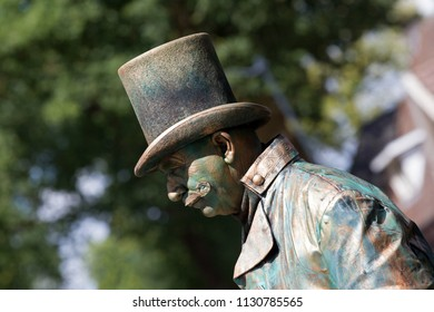Westerbork, Netherlands- July 8, 2018: street artist with a top hat during the Championships living statues in Westerbork, the Netherlands