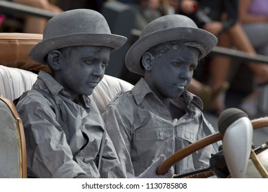 Westerbork, Netherlands- July 8, 2018: young street artists behind the wheel of a classic car during the Championships living statues in Westerbork, the Netherlands