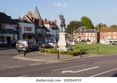 WESTERHAM, UK - MAY 4, 2018: The Green showing General James Wolff Statue and a few people enjoying the afternoon sunshine in Westerham.
