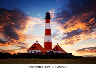 westerhever lighthouse on the coast in Germany at sunset