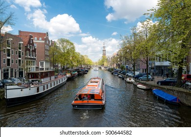 Westerkerk church with cruise ship in canal at Amsterdam, Netherlands.Beautiful spring season in Amsterdam, Netherlands.
