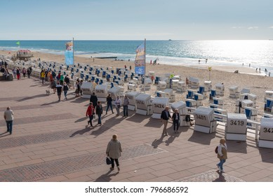 Westerland, Germany 09.03.2017 people and baltic beach chairs on boardwalk and beach of Westerland, Sylt