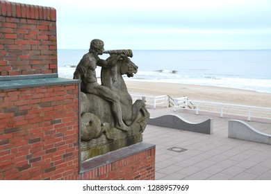 Westerland, Sylt / Germany - December 22nd 2018: Monument statue of triton on a hippocampus made of shell limestone on the promenade  pier in Westerland on the island Sylt in Germany/ Europe