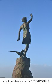 """Westerland, Sylt / Germany - January 1st 2019: """"Save our seas"""" bronze statue on the island Sylt in Germany on New year's day"""