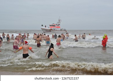 Westerland, Sylt/Germany - December 26th 2018: traditional boxing day swim also called Weihnachtsbaden on the island Sylt in northern Germany. 150 registered participants entered the sea
