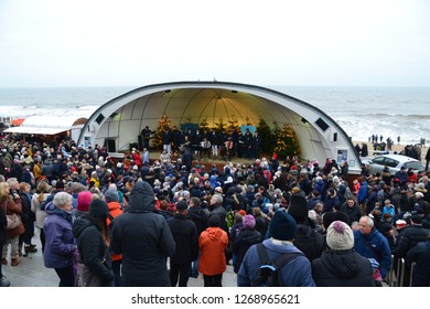 Westerland, Sylt/Germany - December 26th 2018: concert by the Shanty Chor in the open air stage Musikmuschel on the beach promenade on the island Sylt in northern Germany