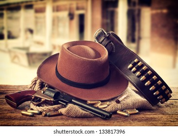 Western accessories on wooden table