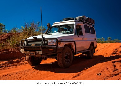Western Australia – Outback track with 4WD car downhill to the ocean at Dampier Peninsula