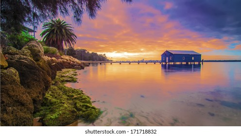 Western Australia - Sunrise View of Perth Skyline from Swan Riverwith Boatshed on the Swan River