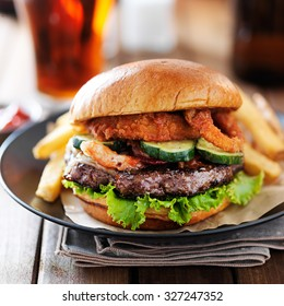western barbecue hamburger with onion rings and french fries