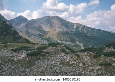 western carpathian mountain panorama in clear day with tourist hiking trails and green forest around. Tatra, Slovakia - vintage retro look