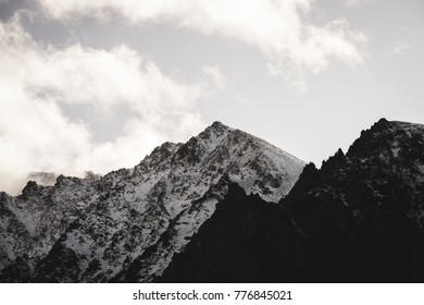 western carpathian mountain tops in  autumn covered in mist or clouds. panoramic view from a distance - soft vintage look