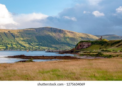 Western coast of County Antrim, Northern Ireland, UK, with the ruin of medieval Red Bay Castle, cliffs near Glenariff, Watrerfoot and Cushendall at coast road A2, a.k.a Causeway Coastal Route
