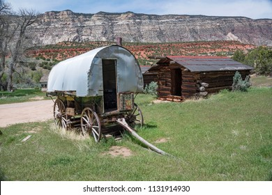 Western Colorado, USA – 7 May 2018: Pioneers Jack and Mary Chew with their sheep herders wagon and log cabin homesteaded and raised sheep in what is now Dinosaur National Monument
