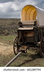 Western covered chuckwagon closeup for cooking food on the trail with storm approaching