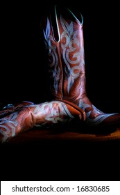 Western cowboy boots on black background